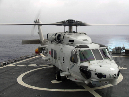 US_Navy_061111-N-6621K-002_A_Japanese_Maritime_Self-Defense_Force_SH-60J_Seahawk_helicopter_sits_on_the_flight_deck_of_guided-missile_destroyer_USS_Curtis_Wilbur_(DDG_54)_after_flying_a_U.S_Navy_liaison_officer_from_JDS_Kiri copy.jpg